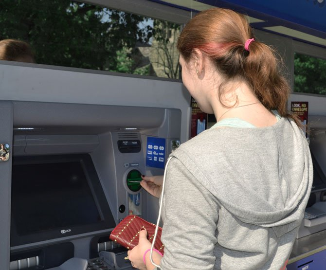 Experts say the convenience of using ATM or debit cards can make financial discipline difficult.