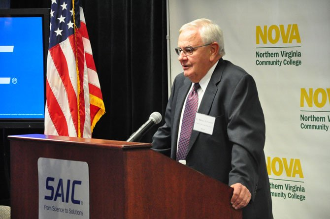 Dr. Melvyn Schiavelli, executive vice president for Northern Virginia Community College, speaks at the SAIC building in Tysons Corner Thursday, Sept. 27, after NVCC received a $12 million grant from the Department of Labor.