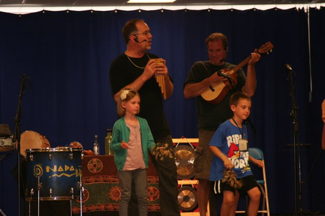 Students play instruments along with Nada Brahma.