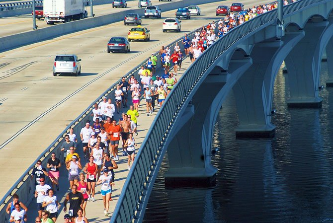 Runners will cross the Potomac River Oct. 7 in the Woodrow Wilson Bridge Half Marathon. Morning traffic from Mount Vernon to the bridge access in Alexandria will be affected.