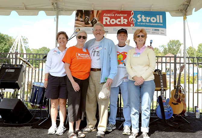 Nonprofit executive directors gather for a photo at the Rock and Stroll walk to end homelessness. From left: Shelley Murphy, Wesley Housing; Pamela Michell, New Hope Housing; Michael O'Rourke, AACH; Ken Naser, ALIVE!; and Bonnie Baxley, Community Lodgings.