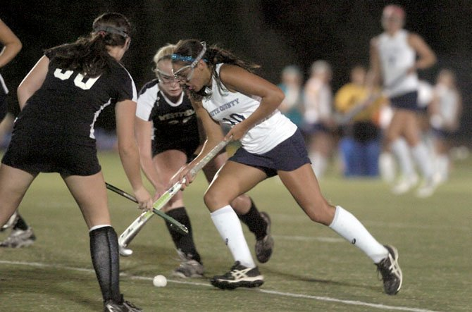 Isabel Josephs and the South County field hockey team lost a 1-0, weather-shortened game against Westfield on Sept. 27.