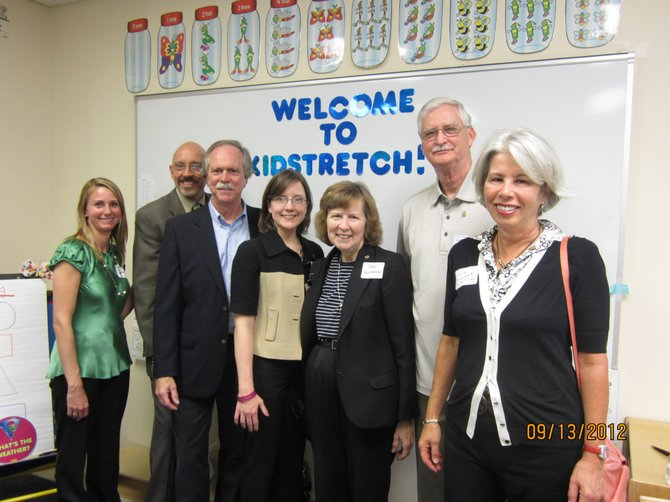 Kim Baker, preschool director; Christopher Fay, Homestretch executive director; Richard Lanier, Tysons Rotary club; Mary Edwards, Tysons Rotary club; Jan Auerbach, McLean Rotary club; Gerry Hamilton, Vienna Rotary club; and Cherry Baumbusch, McLean Rotary club, pictured at the ribbon-cutting ceremony.