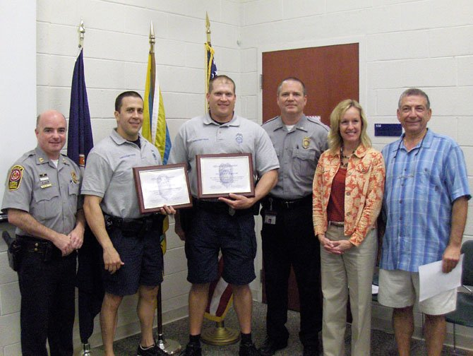From left are Capt. Ed O'Carroll, MPO Garrett Polowy, PFC Adam Jantosciak, Lt. John Trace, and Leslie Jenuleson and Steve Pollard of the CAC.