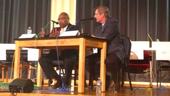 Incumbent Democrat Bill Euille, left, debates independent challenger Andrew Macdonald at George Washington Middle School in the first of three debates.