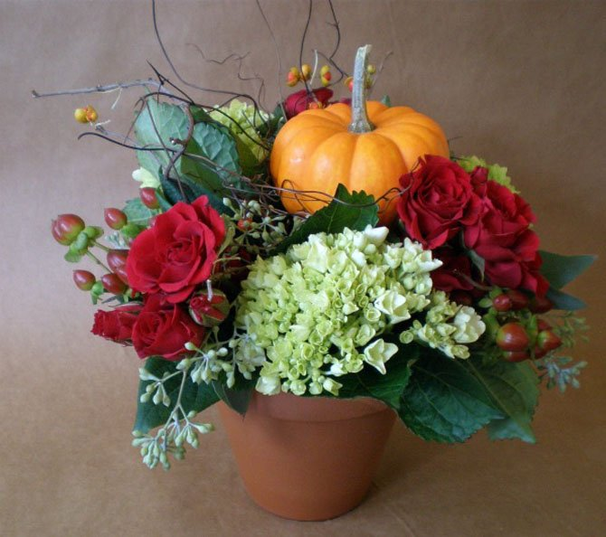 Pumpkins and other fall produce are a popular addition to autumn floral arrangements.