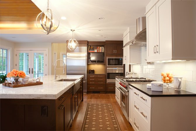 When designing this Potomac, Md. kitchen, Nadia Subaran of Aidan Design used a mix of painted white cabinets paired with a very dark stain on cherry. I think what people like about that look is that it helps to break the kitchen up a little bit, she said.