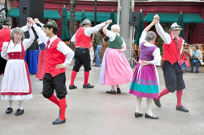 Members of the Alpine Dancers, an ensemble specializing in dance from Austria, Germany and Switzerland, perform at the Reston Oktoberfest Sunday, Oct. 7.