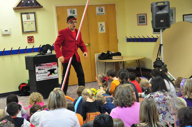 Magician Mike Perrello performs at the Village Green Day School Fall Festival Wednesday, Oct. 3.