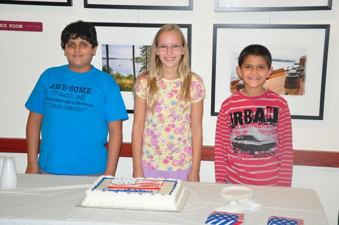 From left, Kavye Vij, Maren Kranking and Sherwin Momenian, participants in the second annual Friends of the Great Falls Freedom Memorial essay contest at the Great Falls Library, Saturday, Oct. 6.