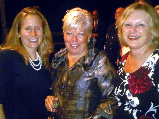 Lizzy Conroy, Marcia S. Twomey (Greater McLean Chamber of Commerce president) and Karen Briscoe at the award ceremony.