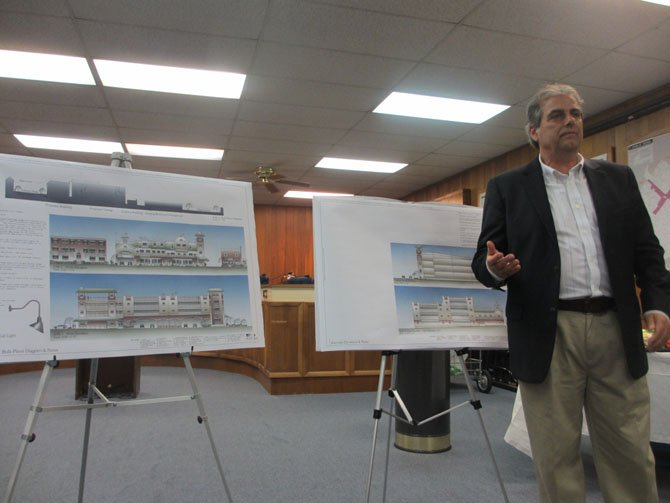 Church Street mixed-use building architect Paul Layer describes the modified elevations to the citizen audience at the public meeting on Sept. 27.