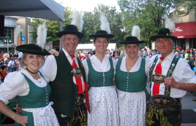 Janet Nagler, Charles Volkman, Claudia Fochios and Angela Kummel perform Bavarian dances in traditional costumes during the Capital City Brewing Company Oktoberfest at the Shirlington Village.