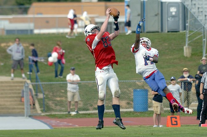 Woodson tight end Peter Murray catches a touchdown pass against T.C Williams on Oct. 6. Woodson earned its first win of the season, beating the Titans, 28-21.