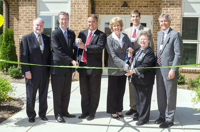 (From left) Jim Chandler, director of LIHTC Credits, VHDA; Delegate David Bulova (D-37); Mayor Scott Silverthorne, City of Fairfax; Jane Henderson, president and CEO, Virginia Community Capital; Stephen Smith, vice president, Enterprise Community Investment, Inc.; Wilma Huff, West Wood Oaks resident; and J. Michael Pitchford, president, Community Preservation and Development Corporation, celebrate the completion of the $6.7 million green renovation of the West Wood Oaks apartments in Fairfax.
