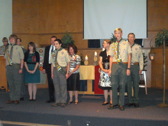 Newly Inducted Eagle Scouts (from left): Eric Lyttek, Michael Marriott and Benjamin Washechek with their parents.