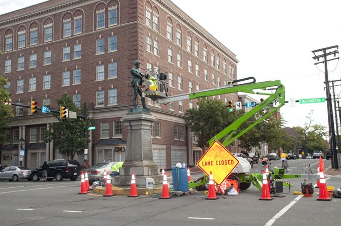"Oscar Bonilla cleans ""Appomattox"" at the intersection of Washington and Prince streets."