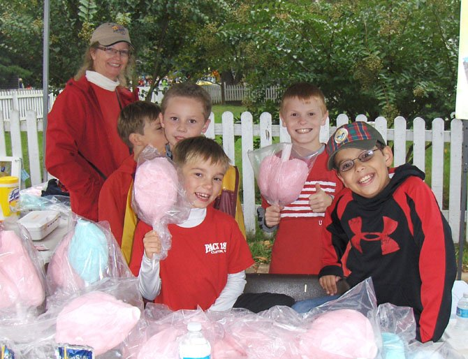 Selling cotton candy are Dariece Rau, assistant leader of Clifton's Cub Scout Pack 1861, with (back row, from left) Nick Richmond, Gannon Rau and Sean Cunningham and (front row, from left) Thomas Mikolashek and John Biamonte.