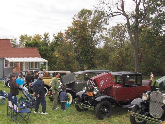 Looking at antique cars near a historic home during last year's Centreville Day.