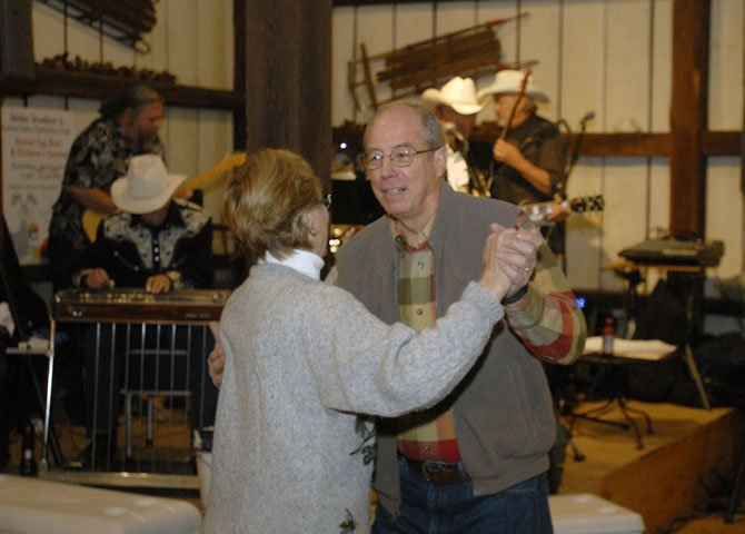 George and Jane Newman enjoy the music of Bennie Potter and Western Electric while attending the 7th Annual Barn Dance sponsored by the Great Falls Optimist Club.