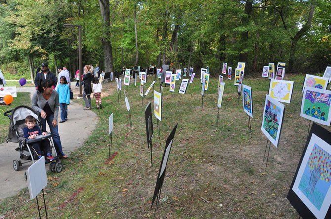 Visitors to the McLean Project for the Arts explore the Children's' Art Walk, made up of local students' work at McLean Central Park Sunday, Oct. 14.