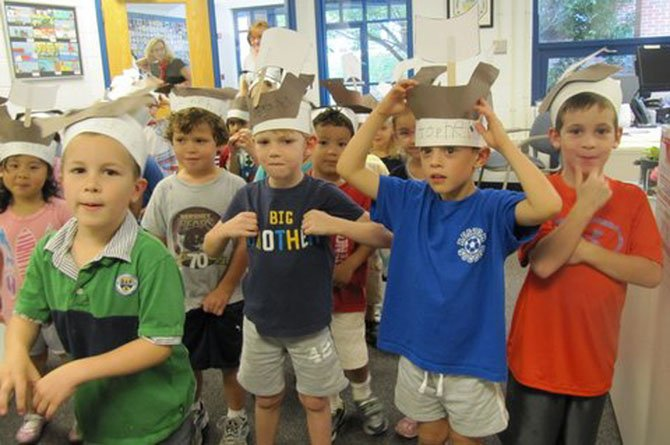 "Mrs. Jan Clark's kindergarteners Erica Dong, Nash Butler, Matthew Troy, John Deringer, Zachary Yellen, Evan Kelly and Carter Cadin perform a rousing rendition of ""O Columbus,"" a song about Columbus' voyage to America."