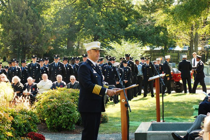 Alexandria Fire Chief Adam Thiel delivers the keynote address at the service.