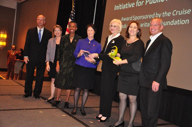 Members of the Initiative for Public Art-Reston are given the Arts Impact Award at the Arts Council of Fairfax County awards luncheon Friday, Oct. 12. 