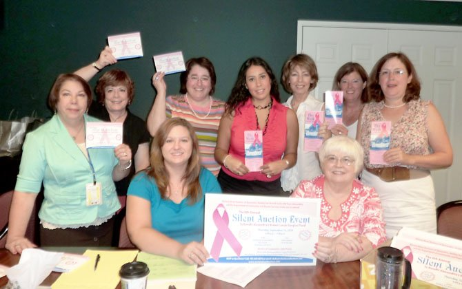 Women Mean Business members, shown prior to last year's silent auction to raise money for the city's breast cancer surgical fund, have decided to disband after 12 years.