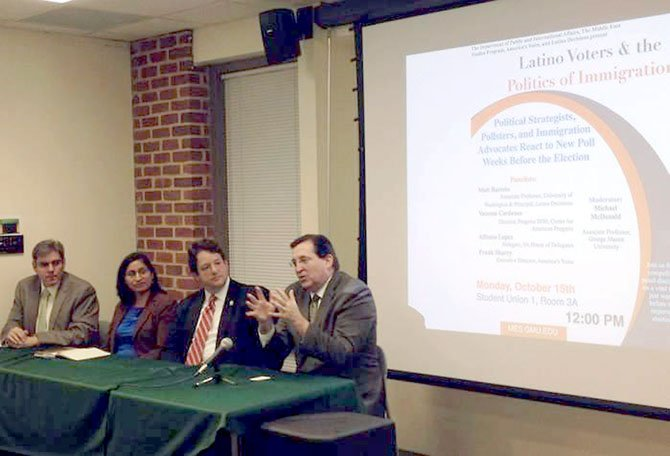 Michael McDonald, (left) a GMU professor and political analyst, moderated a panel discussion Monday, Oct. 13 on the impact of Latino voters in Virginia. The panel included Vanessa Cárdenas, executive director of Progress 2050 Action, Center for American Progress Action Fund; Del. Alfonso Lopez (D-49); and Frank Sharry, executive director of America's Voice.