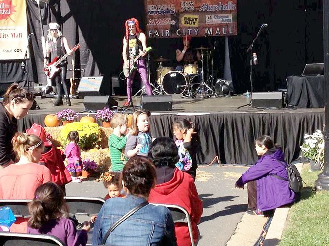 Girlz, Girlz, Girlz—Girls, big and small, rocked out with the pop cover band on the Main Stage during the city's 36th annual Fall Festival on Saturday, Oct. 13.