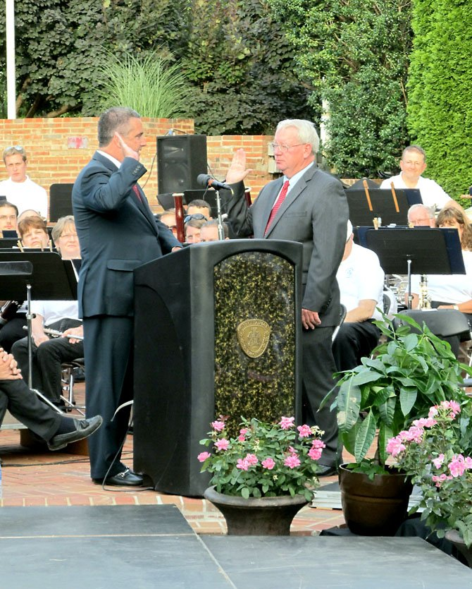 R. Scott Silverthorne becomes the City of Fairfax's 10th mayor during his swearing-in ceremony on June 27 at the City Hall Veteran's Amphitheater. The oath of office was administered by Clerk of the Court John Frey.
