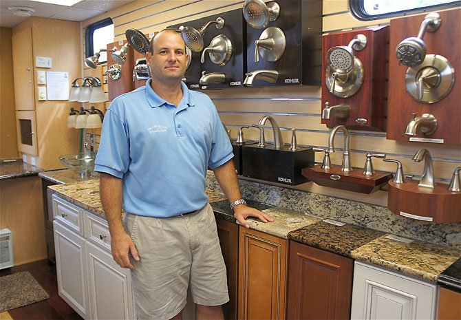 Jeff Pregman, general manager of Two Poor Teachers, shows off just a few of the items on display in the company's mobile showroom.