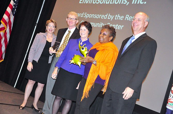 Employees of EnviroSolutions receive the Arts Philanthropy Award for their contributions to the Workhouse Arts Center in Lorton. They were given the award by the Arts Council of Fairfax County at their awards luncheon Friday, Oct. 12.