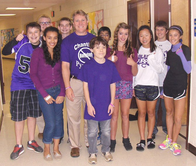 Rocky Run Principal Matt Eline with a group of eighth-grade students on Bullying Awareness Day.