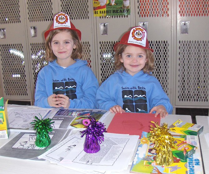 The Calder sisters of Fair Oaks (from left) Allison, 7, and Lindsey, 4, prepare to color pictures at the open house.