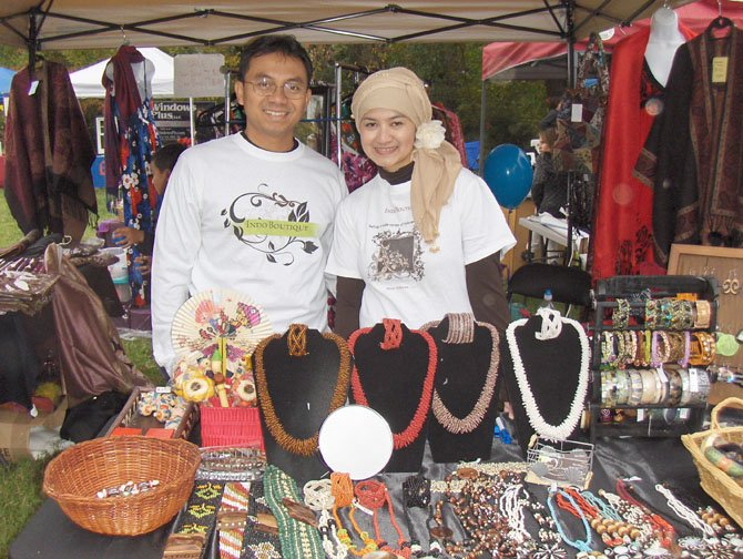 From left: Vendors Bomo and Dyan Wibowo display handmade jewelry from Indonesia during Centreville Day 2011.