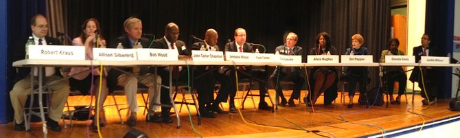 All 12 candidates gather for a debate at Lyles-Crouch Traditional Academy.