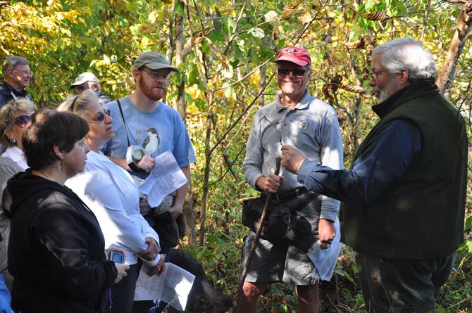 Jim McGlone of the Virginia Department of Forestry shows how large the thorns on a Honey Locust tree can get during the Riverbend Park Tree Walk Sunday, Oct. 21.