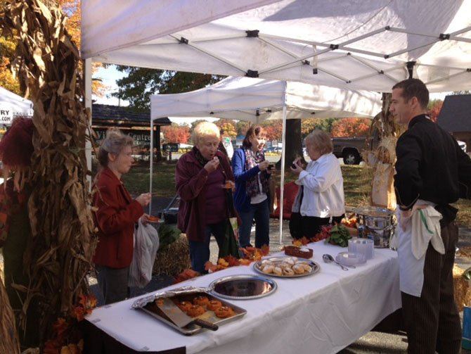 John Conway, The Old Brogue's master chef, looks on as Farmers Market visitors enjoy his freshly prepared creations.