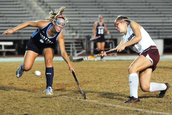 Yorktown's Tierney Patton, left, reaches in to defend against Mount Vernon's Lizzy Sagar during the National District field hockey championship game on Oct. 22 at MVHS.