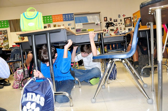 Langston Hughes Middle School students participate in the U.S. Geological Survey's ShakeOut drills Thursday, Oct. 18.
