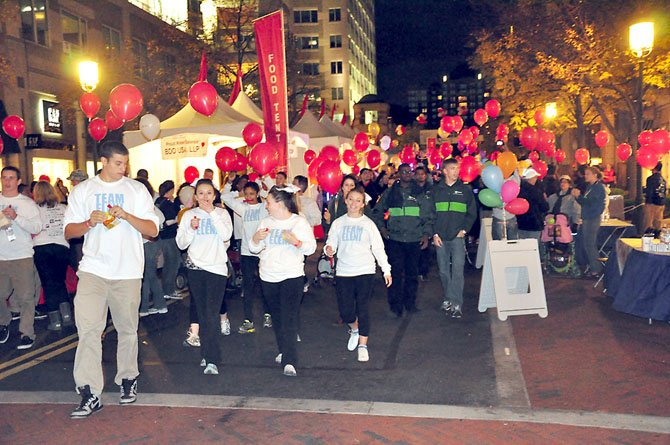 Walkers at the annual Light the Night Walk participate in the annual fundraiser for the Leukemia and Lymphoma Society Saturday, Oct. 20 at Reston Town Center.