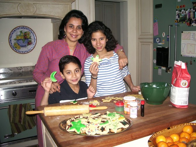 Salma Hasan Ali, Saanya Ali, 16, and Zayd Ali, 10, bake moon and star cookies by the dozen, for neighbors, classmates and friends.