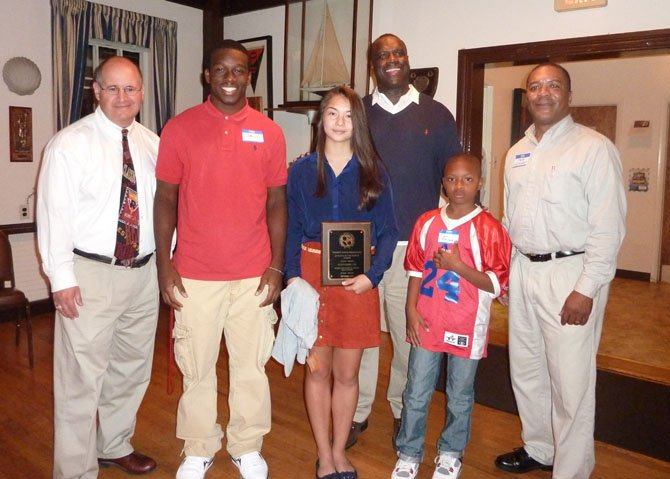 Washington Redskins great Dexter Manley presented the Athletes of the Month awards Oct. 16 at the Alexandria Sportsman's Club meeting at the Old Dominion Boat Club. Pictured are Redskins historian and author Mike Richman, Darius Manora (SSSA football), Stephanie Lin (BIHS girls tennis), Jaden Thrash (85lb American Division, Alexandria Titans Youth Football) and club president Jeff Murphy.