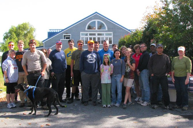 Volunteers gather in front of the Dee Campbell Boathouse at the conclusion of the waterfront clean-up
