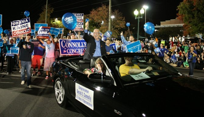 Elected officials and political hopefuls marched or rode in the Vienna Halloween Parade. U.S. Rep Gerry Connolly (D-11) greets the crowd.