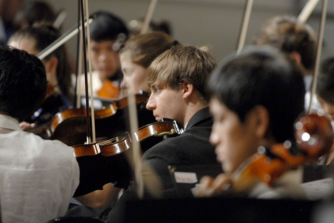 The Langley High School Orchestra performs a selection of Asian music during their performance titled Spirited Away, on Thursday night.