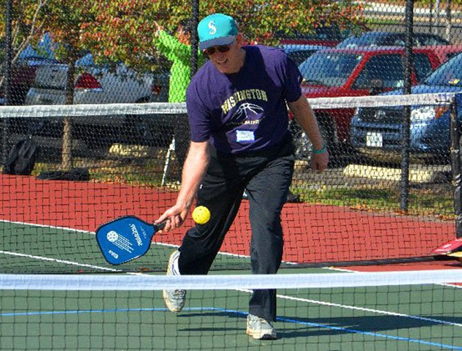 Rob Cahill of Arlington, former national doubles pickleball champion, played Oct. 20 at the Walter Reed Community Center tennis courts with over 45 players from Delaware, Maryland, Virginia and Jamaica.