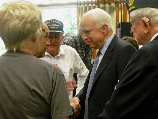 Sen. John McCain (R-Ariz.) talked with residents at Greenspring retirement community in Springfield on Friday, Oct. 26. The senior senator from Arizona was stumping for GOP presidential candidate Mitt Romney. (From left) residents Charles Fletcher, John Schultz and Tom Harrison.